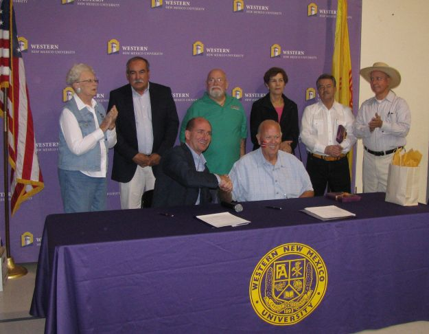 Mayor Skinner (on R at table) with Dignitaries After Signing Agreement to Have WNM University Offer Classes in Columbus