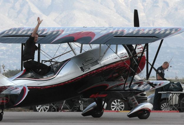 Kyle Franklin waves to crowd from his customized Waco Biplane at Amigo Airshow 001