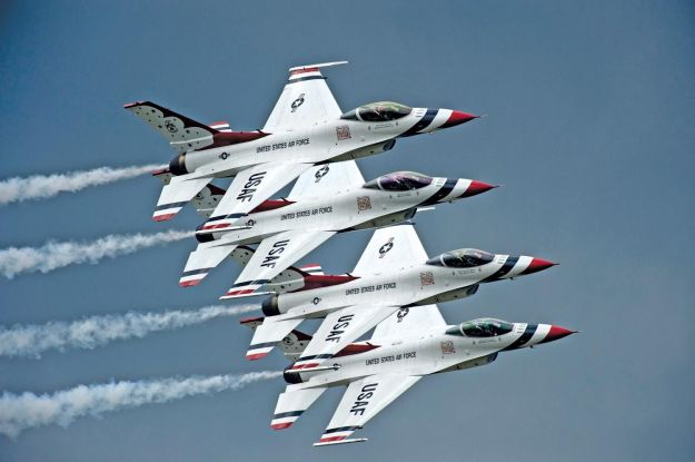 Four of the six Thunderbirds fly by in echelon review at almost 400 MPH.