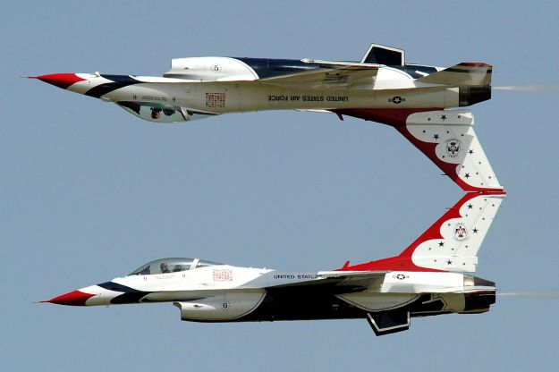 "The amazing USAF Thunderbird Exhibition Team thundering by the crowd in their renowned ""Calypso Pass"" maneuver at over 500 MPH!"