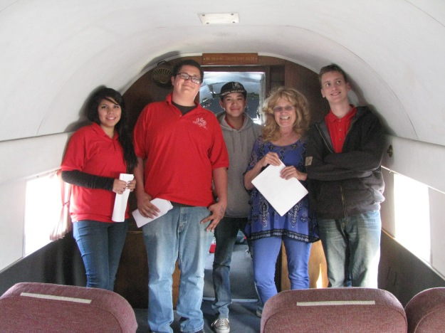Above, L to R,  are Veronica Nolasco, Tracy Piscopo, Alan Salgado, Kathy Rohm (Tom Wathen Center Program and Tour Coordinator) and James Jordan.  All except Kathy are student Interns at the Waltham Center.  The group is  standing inside the Flabob Airport's own fully restored and operational DC-3 vintage airliner cabin.
