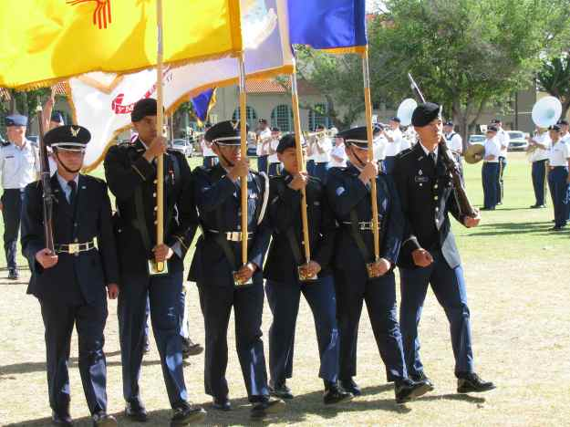 Passing in Review are the combined ROTC Color Guard, with L to R above: AF Cadet Weston Stutzman; Army Cadet Sergeant First Class Brian Webb; AF Cadet Capt. Victor Acosta; Army Cadet 2nd LT Krista Gatan, AF Cadet Angelica Helton; Army Cadet 2nd LT Richard Buck
