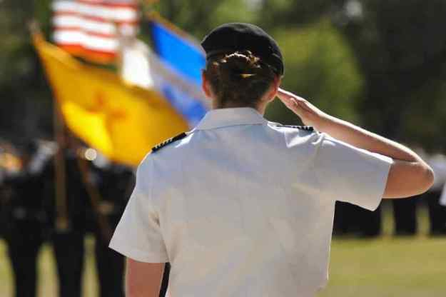 Above, Army ROTC Cadet Captain Polly Raley saluting the Colors - Photo by Rosie Woller of NMSU