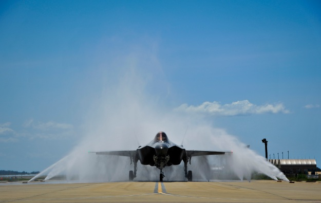 "Lt. Col. Christine Mau, 33rd Operations Group deputy commander, navigates her F-35A through the ""bird bath"" after returning from her first flight on Eglin Air Force Base, Fla., May 5, 2015. Mau, who previously flew F-15E Strike Eagles, made history as the first female F-35 pilot in the program. (U.S. Air Force photo/Staff Sgt. Marleah Robertson)"
