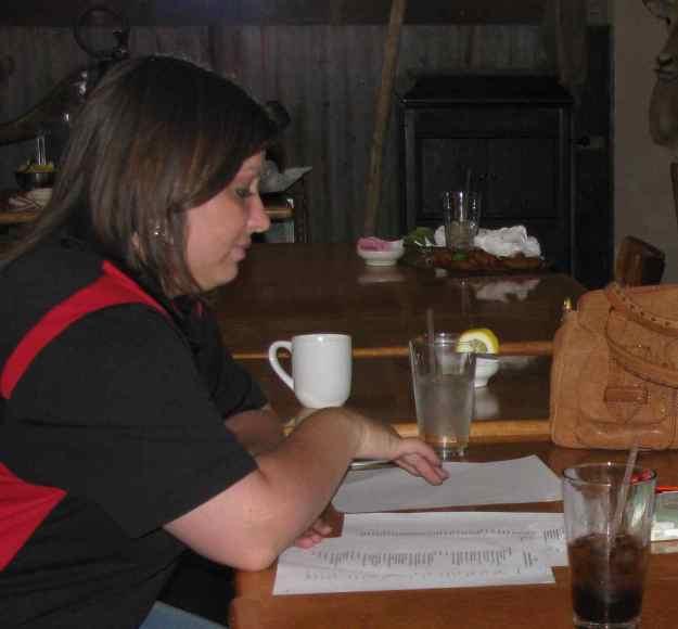 Trustee Megan Wenzel studying proposals.