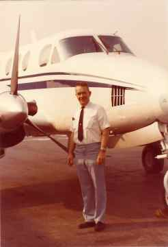 Len as a professional corporate pilot by his Beechcraft King Air Jet Prop twin engined ship.