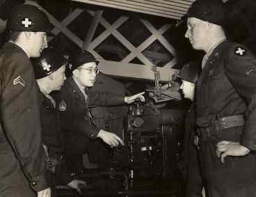 Sgt. Len instructing Soldiers on Artillery Piece Operations