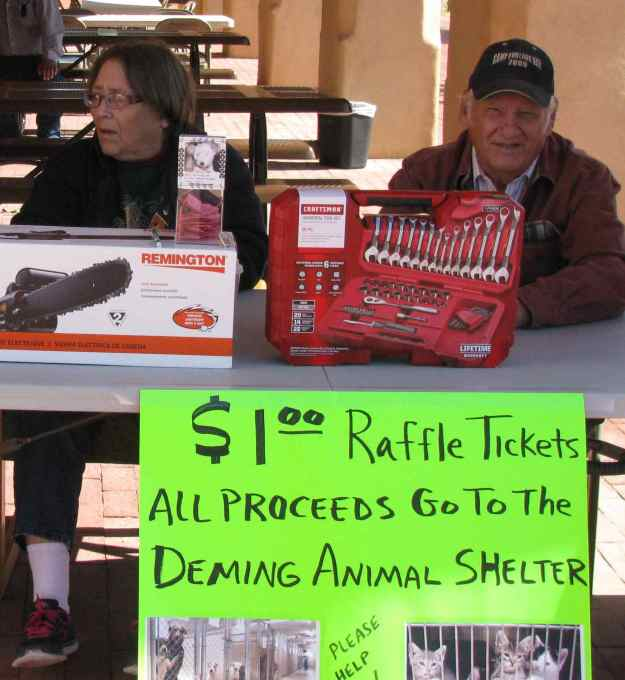 Jeane and Bud Canfield at booth to help raise funds for the Deming Animal Shelter. Bud is a retired FASF Officer and Trustee.