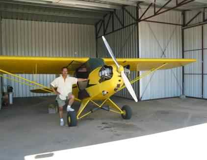 Cabi and his vintage Piper j-3