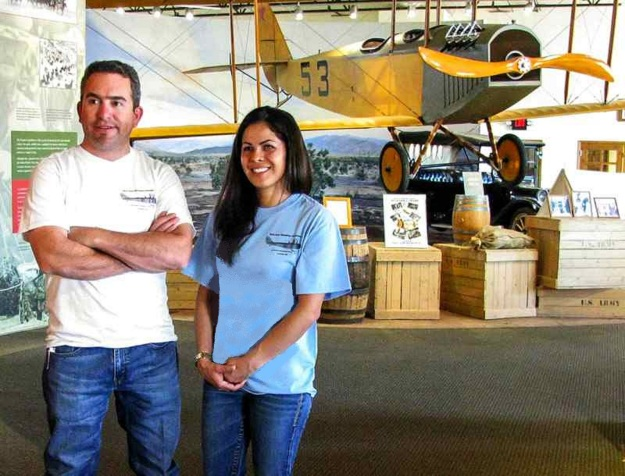 FASF Trustee, Bill Wallace III, of Columbus and Casas Grandes, Mexico, and FASF member, Maria Rangel, of Deming, NM, show off our new T-Shirt designs at the Pancho Villa State Park Exhibition Hall in front of the First Aero Squadron Jenny display. Just click on any photo on our website to see the full-sized version.