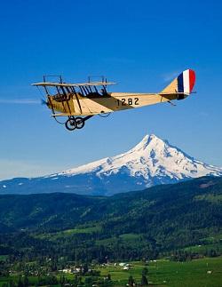 Terry Reed in JN-4 #1282 Flying by Mt. Hood
