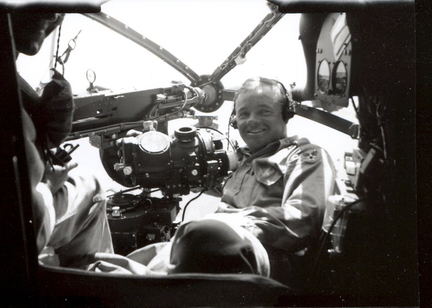 WWII photo of 2nd Lt Everett Glen Hayes posing with his cherished Norden Bombsight in the nose of a B-26 Marauder bomber.