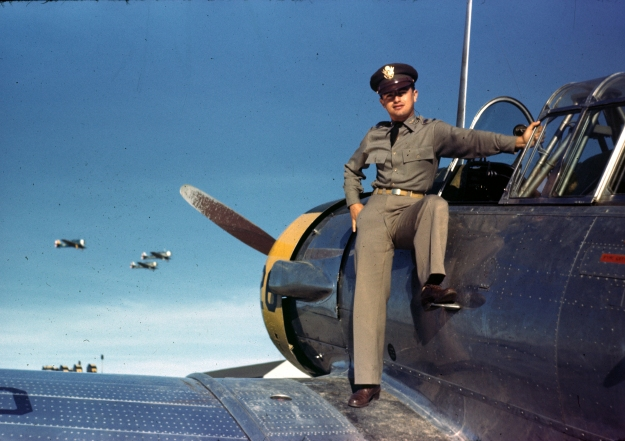 "Bob Cardenas on wing of T-6 ""Texan"" Trainer in 1942 at Kelly AFB in San Antonio Texas."