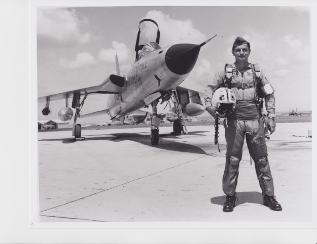 "The General Standing proudly in front of his F-105 ""Thunderchief"" fighter."