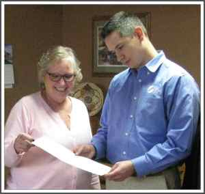 In photo above Josh studies the final Warranty Deed as Kathy Quarrell appreciates the achievement it represents for the FASF