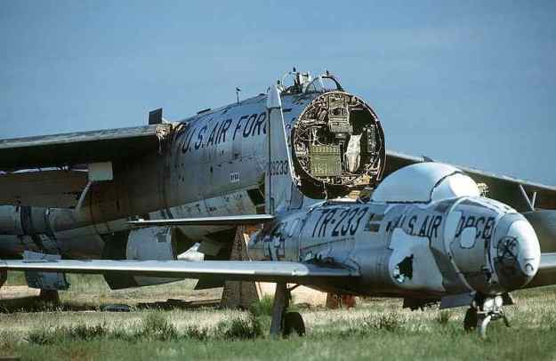 In foreground is a partially dismantled Lockheed T-33 Trainer, which in the early to mid 1950's was the first jet flown by most Air Force and Navy Pilots in their training experiences.