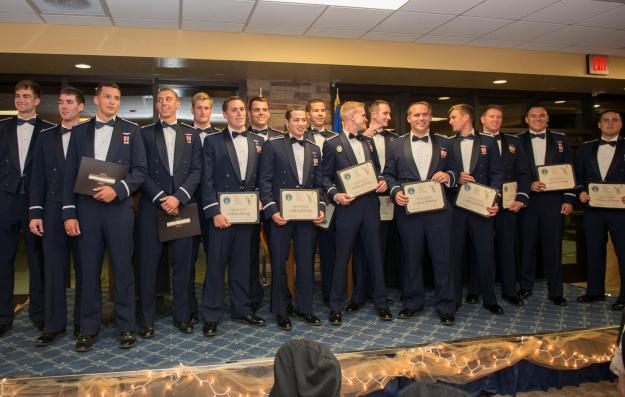 "All 17 Graduating F-16 Fighter Pilots of Class 15-BBH* with Diplomas proudly in hand. *[15 represent the year the class began training: 2015, and the 1st ""B"" means the second class that year; the 2nd ""B"" stands for Basic Training; and the ""H"" is for Holloman AFB]"