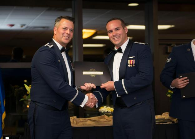 314th Fighter Squadron Commander, Lieutenant Colonel Andrew Caggiano, presents his Graduation Certificate to Captain Pug Ross, recipient of the Daedalian Leadership Award.
