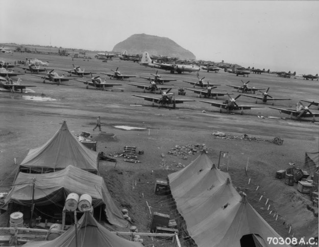 Hundreds of P-51 Mustangs and various bombers parked after airfields taken by Marines