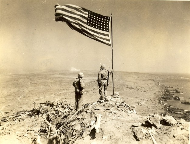 Marines gaze out by the Suribachi Flag to the North over Iwo Jima battlefield