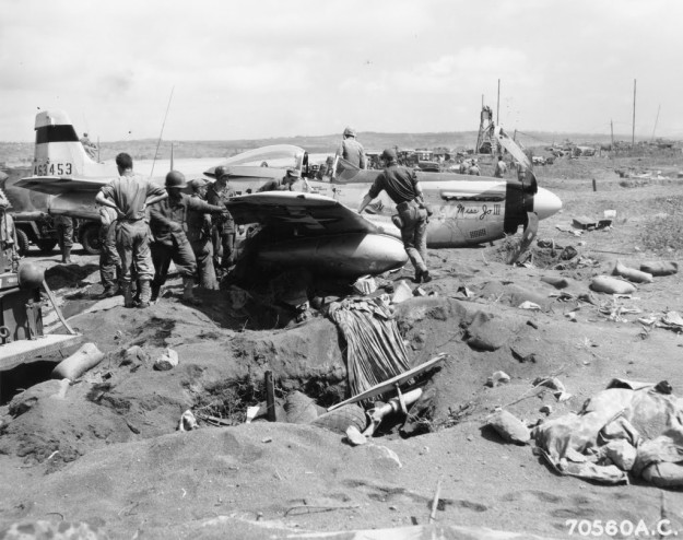 "Wreckage of Lt. Dalquist's North American P-51 ""Miss Jo III"" of the 78th FS, 15th Fighter Group, which cracked-up"" at the 7th Air Force base on Iwo Jima, Bonin Islands on 10 March 1945."