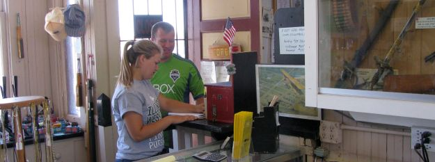 At Left is Katie with her father, Jason, signing the visitor Register at the CHS' Depot Museum.