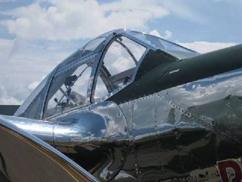 14) The cockpit windows couldn't be opened in flight, because they caused buffeting on the tailplane. This made the cockpit very hot in the Pacific theater. Pilots often flew in just shorts, tennis shoes and a parachute.
