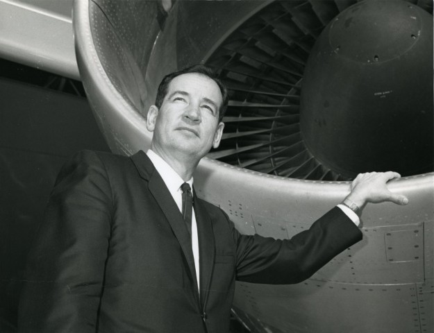 A younger Joe Sutter stands by the engine cowling of his creation, the Boeing 747