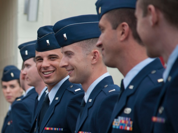 The young men and women graduates who have just won their silver USAF Pilot Wings at Vance Air Force Base in Oklahoma.