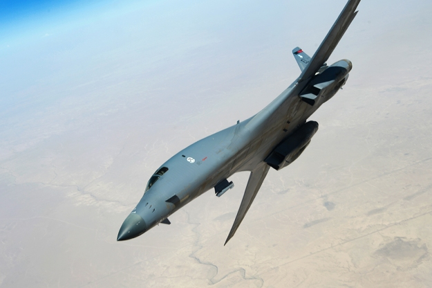 A U.S. Air Force B-1B Lancer departs after refueling from a USAF KC-135 Stratotanker from the 340th Expeditionary Air Refueling Squadron over Southwest Asia during a mission in support of Operation Inherent Resolve, July 23, 2015. OIR is the military intervention against Daesh. (U.S. Air Force photo by Staff Sgt. Sandra Welch)
