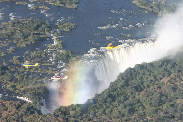 Old Airplanes of Rally Flying towards and over Victoria Falls