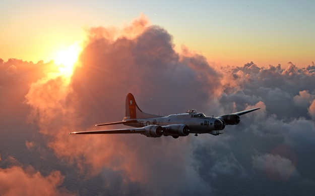 "EAA's own restored WWII Flying Fortress Bomber, ""The Aluminum Overcast"" captured in Flight."