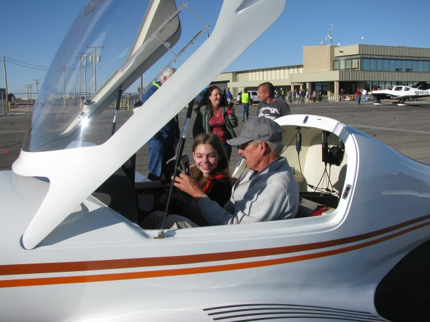 Melissa's husband, John Keithly, president of EAA Chapter 1570, explains the flight plan to Young Eagle