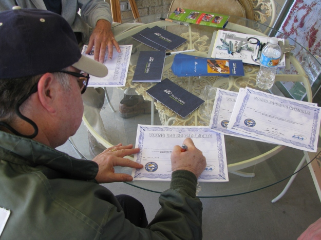 Of course, the final step in each Young Eagle's flight experience is the documentation, including both a new Pilot's Logbook and a Flight Completion Certificate