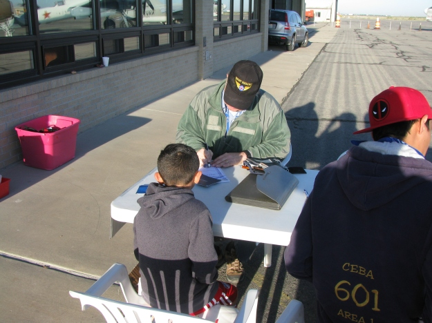 FASF Advisor, Colonel John Orton, signs up a Young Eagle for his first flight.