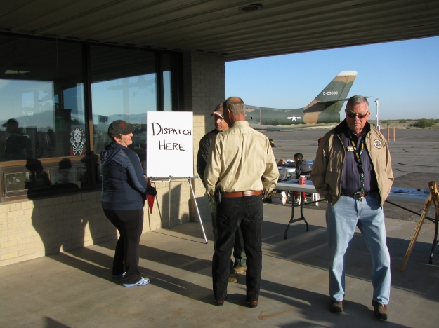 Volunteers Bob Dockendorf, Executive Director of the War Eagles Museum (in background) on the far right, and Deb Rothschild, Rotary Wing and Fixed Wing Flight Instructor, seen at far left, getting ready for the Young Eagles event.
