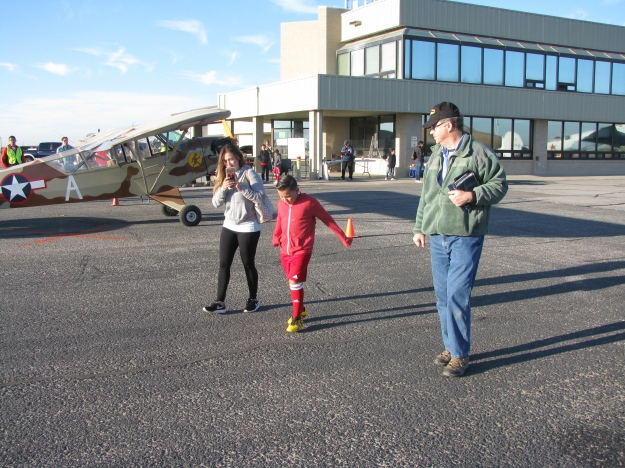 Colonel Orton walks his next Young Eagle and his sister out to their flight.