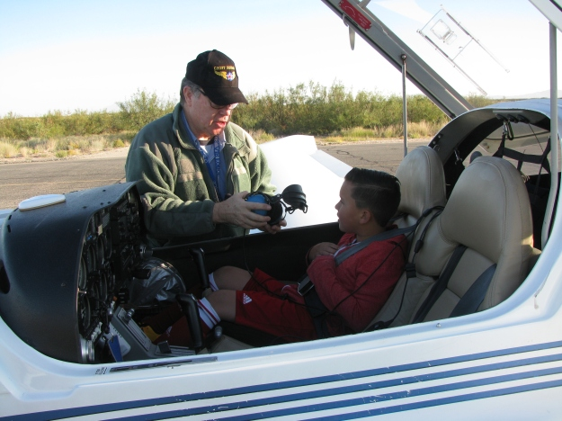 Colonel Orton explains to this Young Eagle how the headset works.