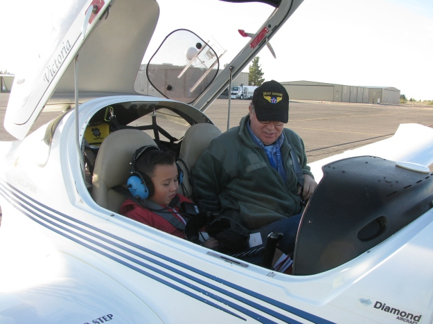 Colonel Orton makes sure his Young Eagle student is comfortable and his seat belt properly secured.