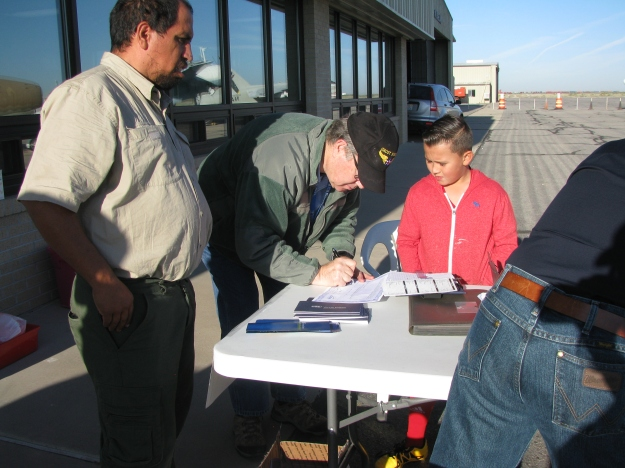 Colonel Orton filling out his Young Eagle's Pilot Logbook after their flight.