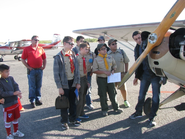 Boy Scout Troop members listen to their Pre-Flight briefing by one of the Chapter 1570 Volunteers. They are learning the important parts of the airplane.