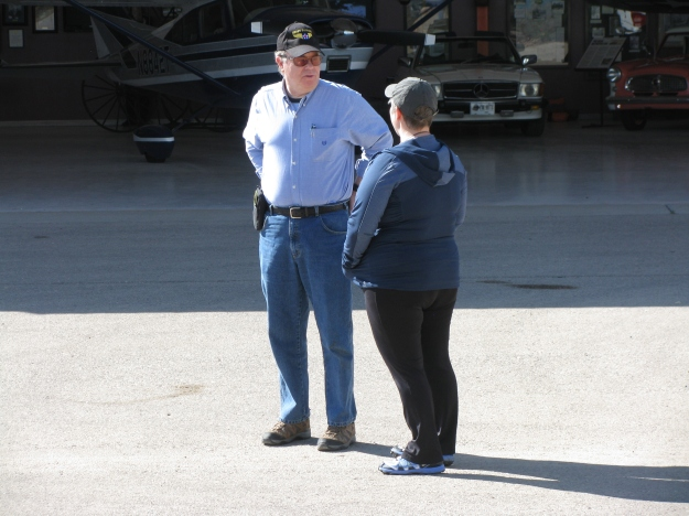 Colonel Orton discusses the event's success with Flight Instructor volunteer Deb Rothschild (R).