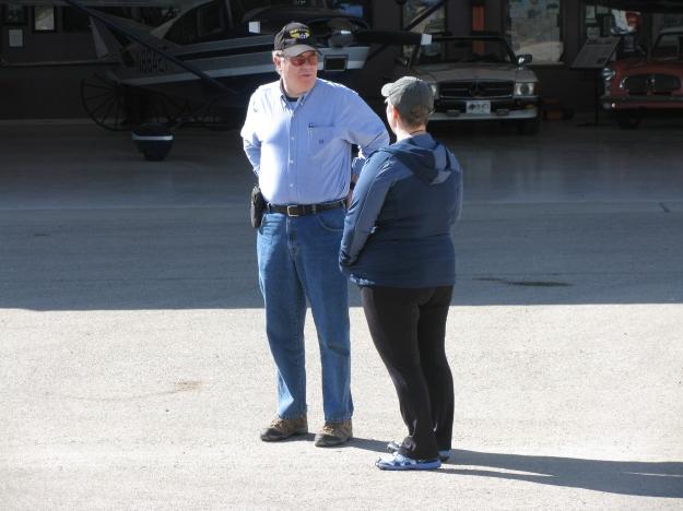 Colonel Orton discusses the event's success with Flight Instructor volunteer Deb Rothschild (R).