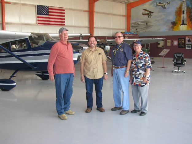From L to R: EAA members and volunteers; Mike McNamee (in whose hangar they are all standing); Judge Alex Gonzalez; Bob Dockendorf; and Roger Nichols getting read for post event celebratory luncheon.